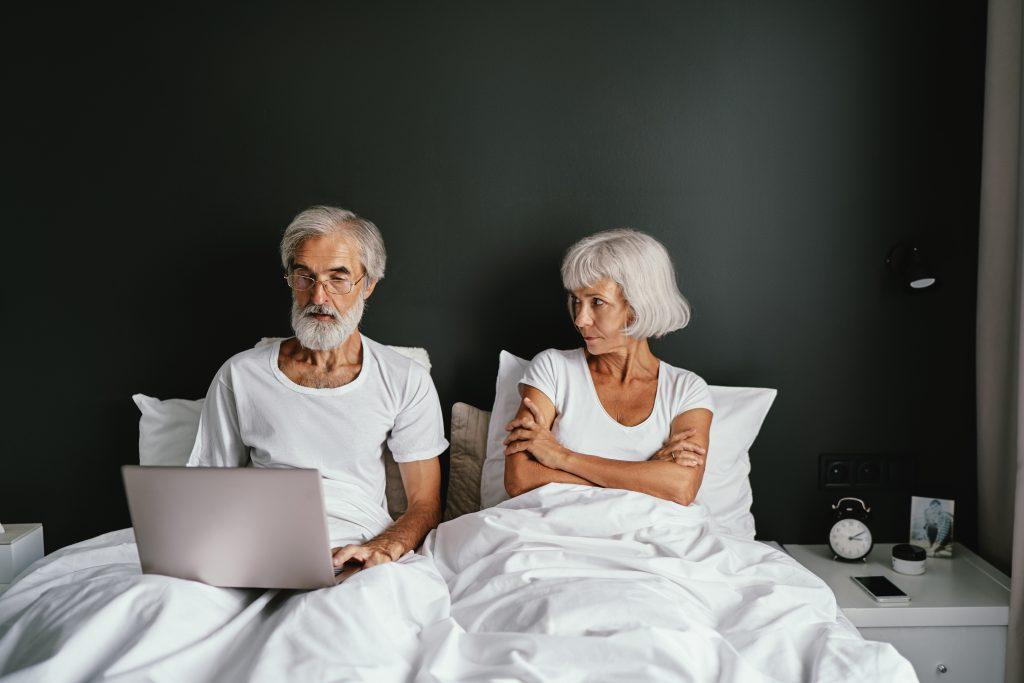 Woman upset and man looking at computer